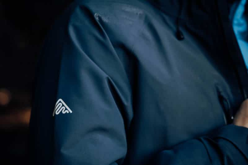 Cortazu logo on navy jacket