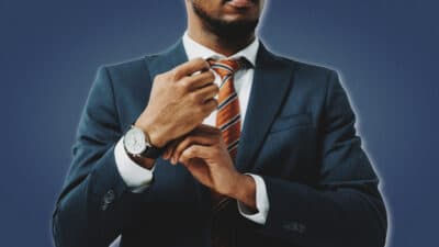 How to Command Respect African American Man in Fitted Suit Adjusting Watch Strap