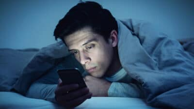Oneitis Man in Bed with Phone Sad Waiting for a Text Message From His Crush