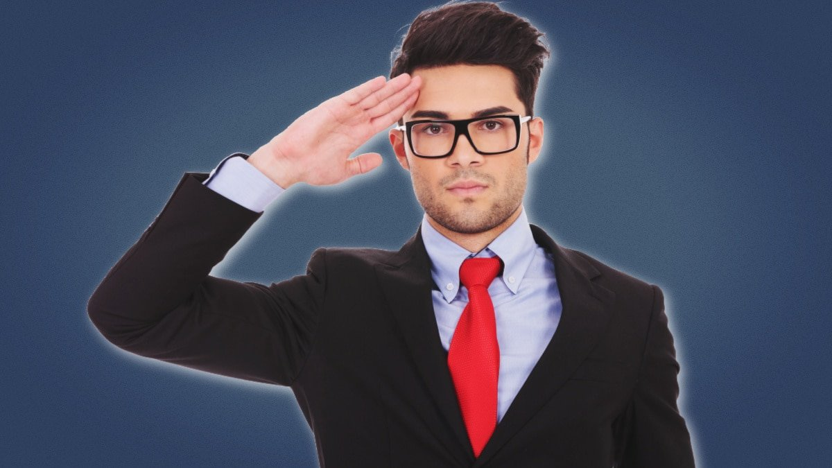 Beta Male Attractive Business Man in Suit With Red Tie Saluting