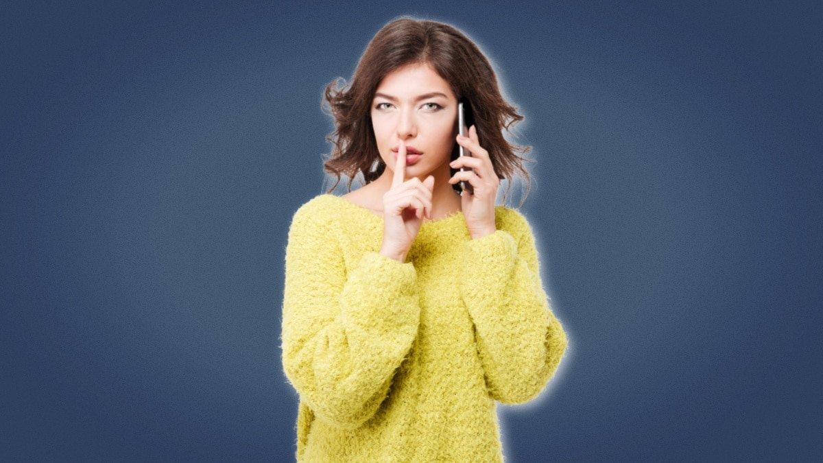 Cheating Girlfriend Girl in yellow sweater on phone making shh noise