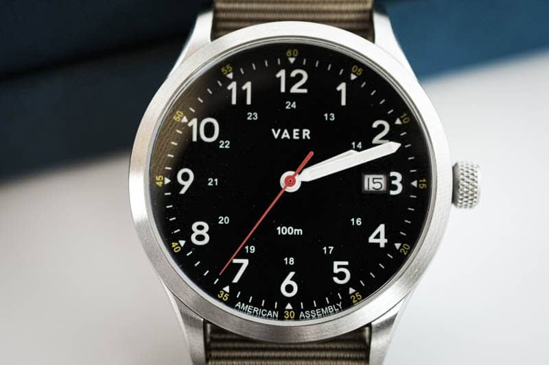 vaer c5 closeup on black dial heritage field watch red second hand detail