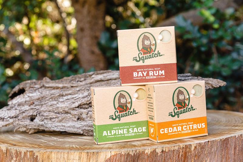 Dr. Squatch three soaps on tree stump