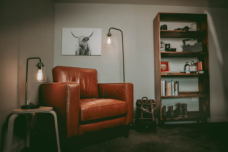 broad view of man cave with leather chair