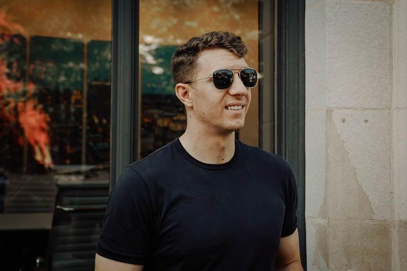 model smiling wearing knockaround sunglasses