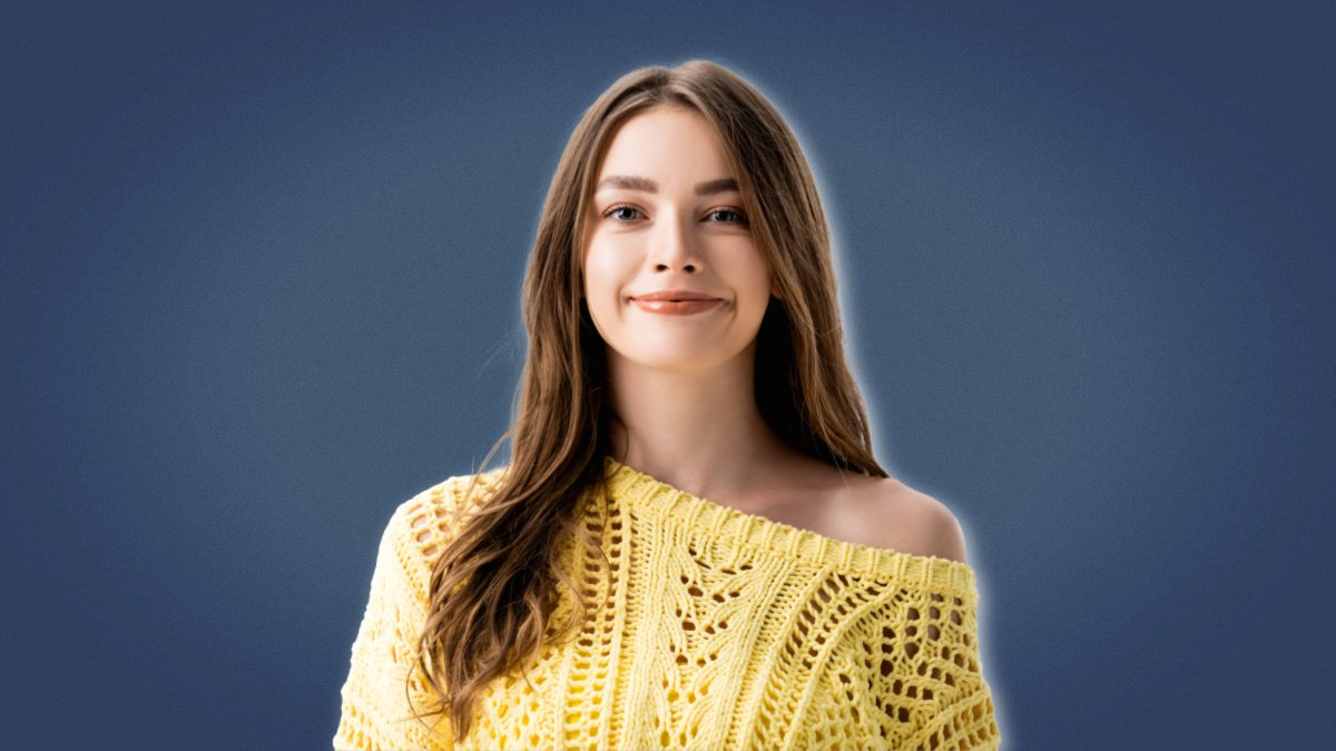 High value woman Attractive brunette girl in yellow top smiling