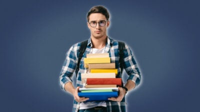 Life Lessons for Men Student With Glasses and Backpack Holding a bunch of books