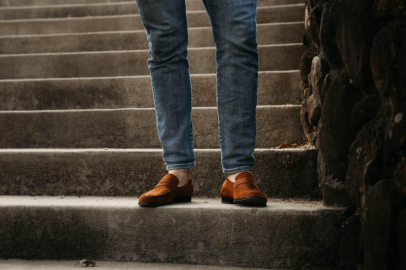 Wolf and Shepherd loafers gold standing on steps