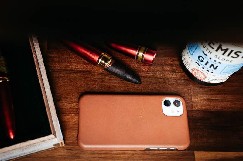 Anson Calder iphone case against wooden shelf