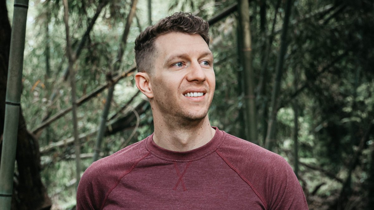 Mens Hair Styles Male Model Smiling at Camera With Curly Fade Hair Style