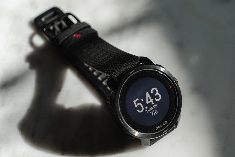 Polar Vantage Grit X watch face detail on marble