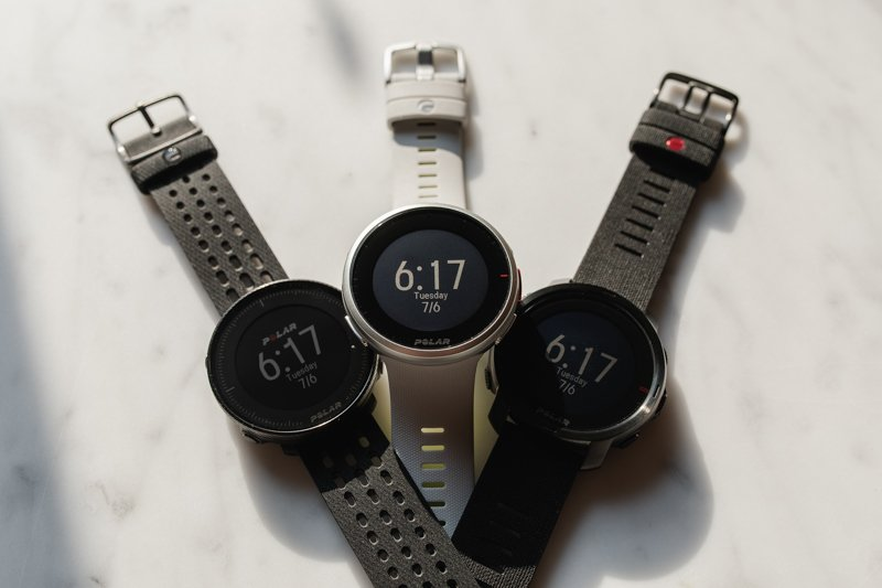 Polar watches overlapping on marble
