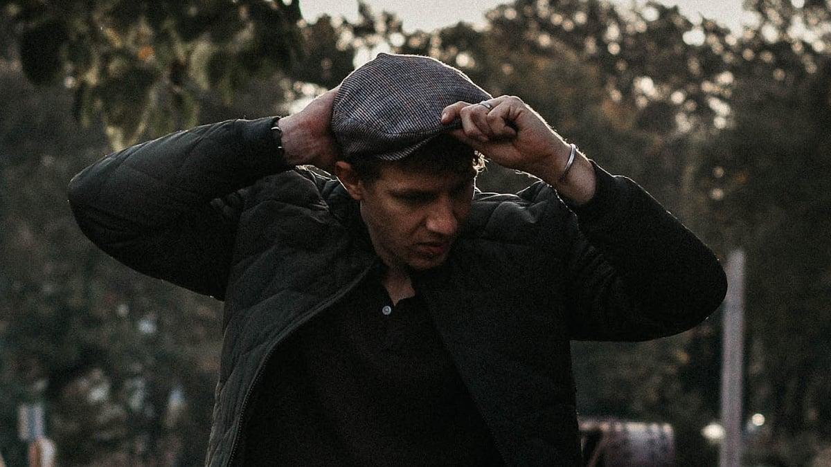 Types of hats Male model holding Brixton flat cap