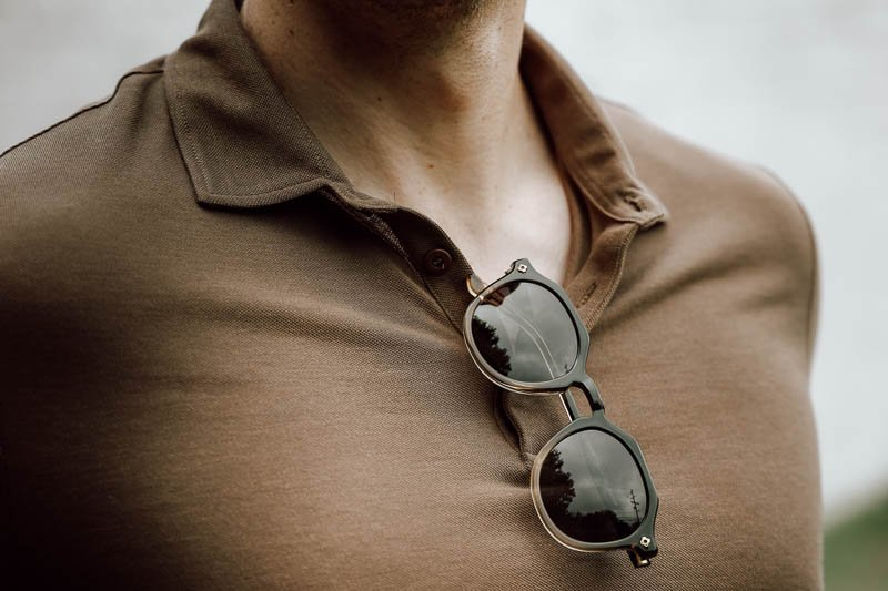 selfmade sunglasses tucked into shirt