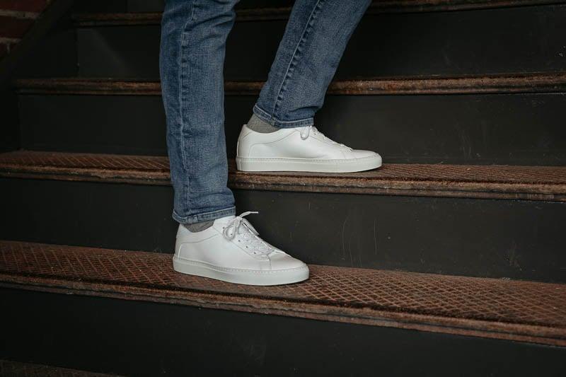 KOIO capri triple white sneakers on stairs
