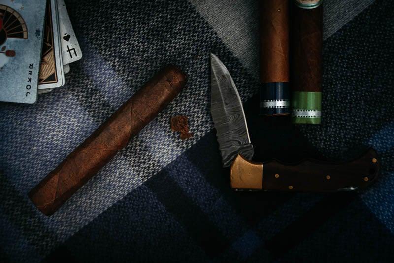 La Aurora cigar cut with knife