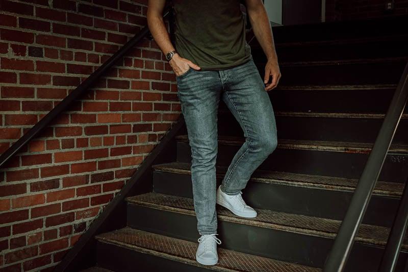 model wearing KOIO sneakers