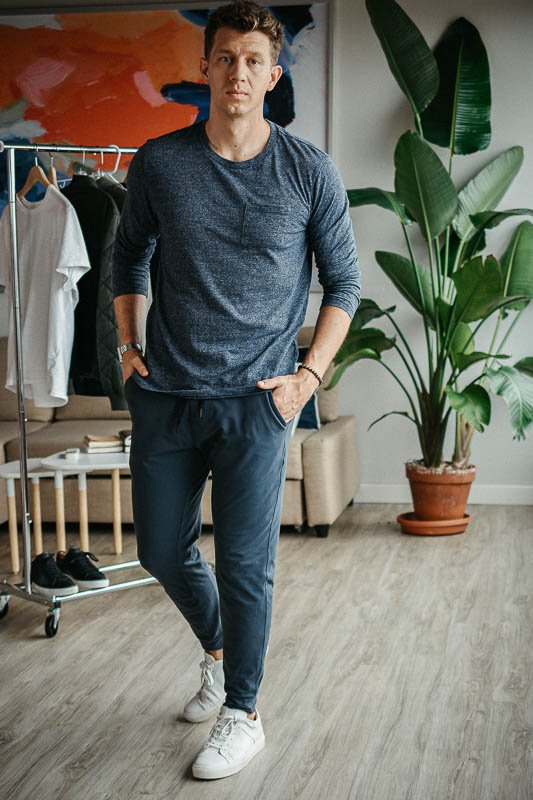 model wearing blue shirt and grey public rec all day every day joggers