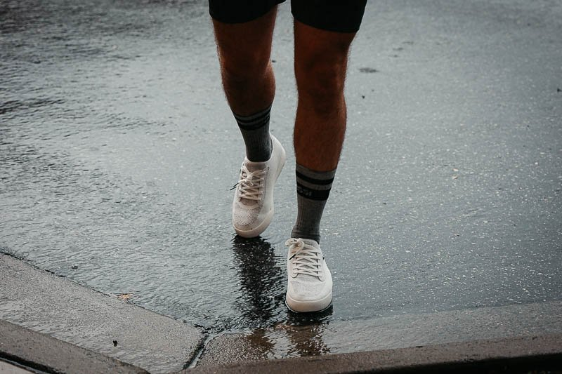 vessi white sneakers in a puddle
