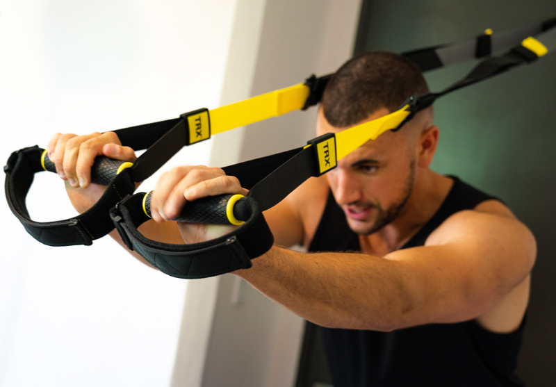 Man doing triceps TRX 1