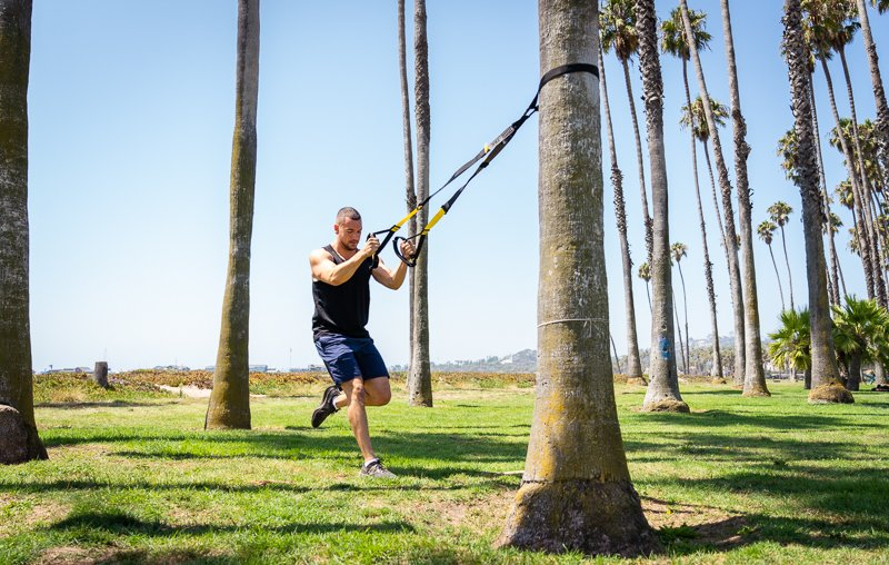 Man outdoors using TRX