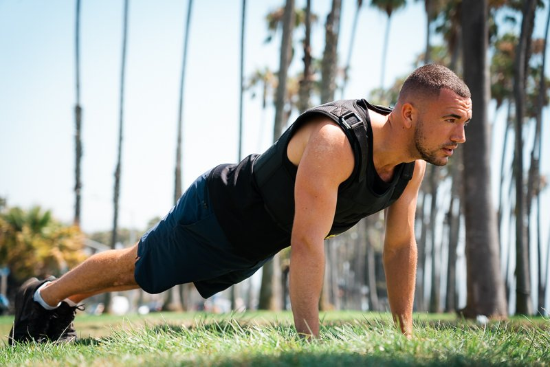 Model doing push up in TRX weight vest