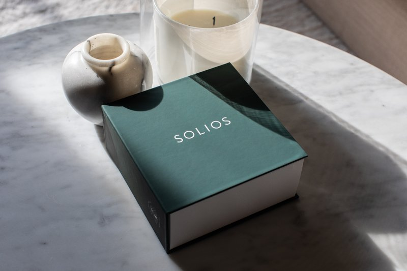 Solios packaging on marble table from the side
