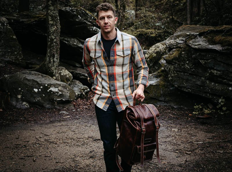 model wearing blanket shirt from outerknown with leather bag