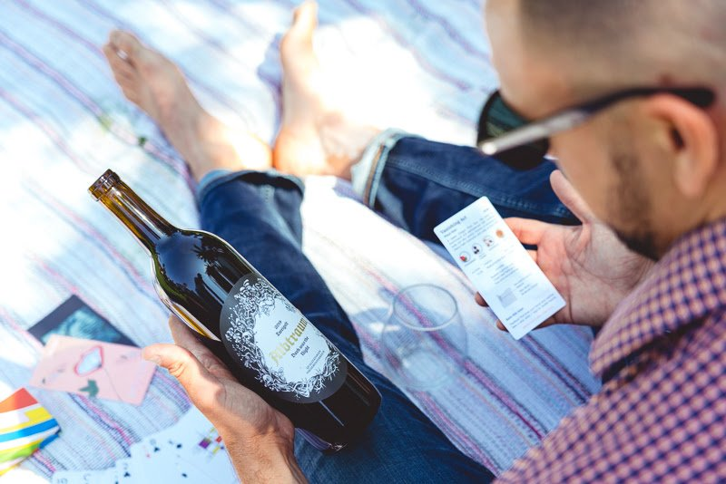 Man learns about wine in park