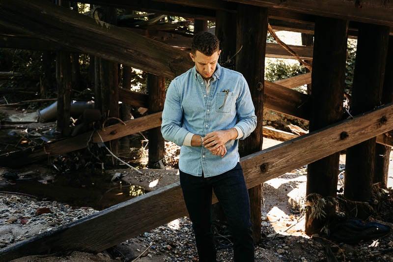 model wearing GAP denim shirt checking watch